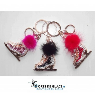 https://www.sports-de-glace.fr/6115-thickbox/porte-clés-patin-strass-pompon.jpg